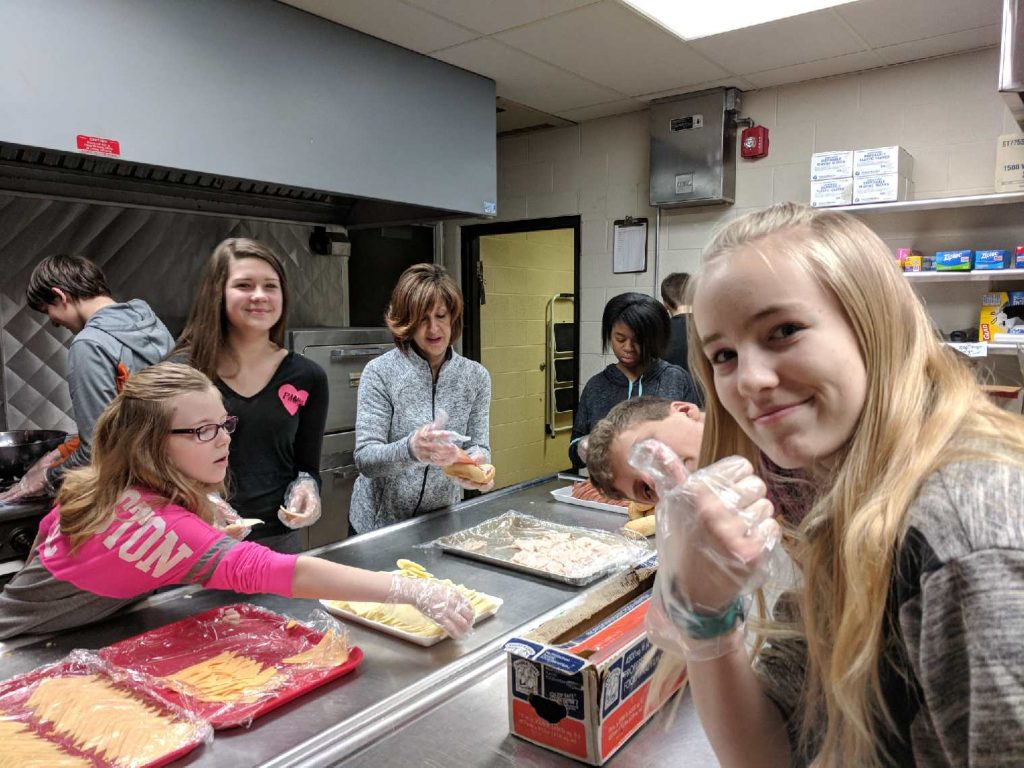teen-agers working in the church kitchen