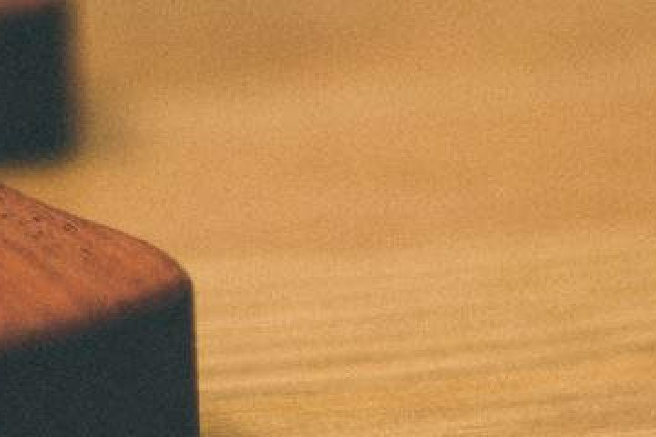 wooden cross on tabletop