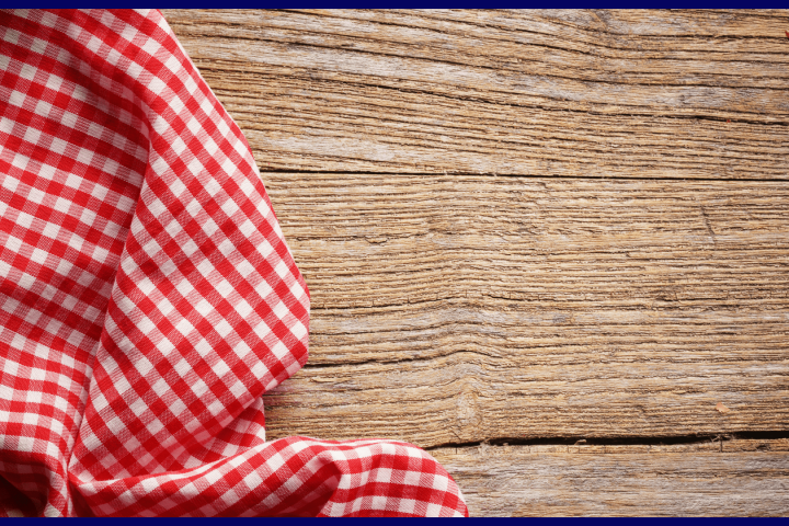 red and white checkered tablecloth on a wooden table