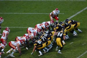 two football teams at the line of scrimmage