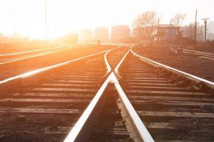2 intersecting railroad tracks at sunset
